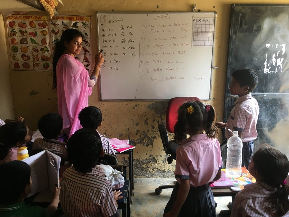 Over the course of our partnership with APS, we have developed a strong relationship with Sandhya, an elementary school teacher. We've been inspired by her passion to offer excellent education for APS' students, and the students equally love and appreciate her!