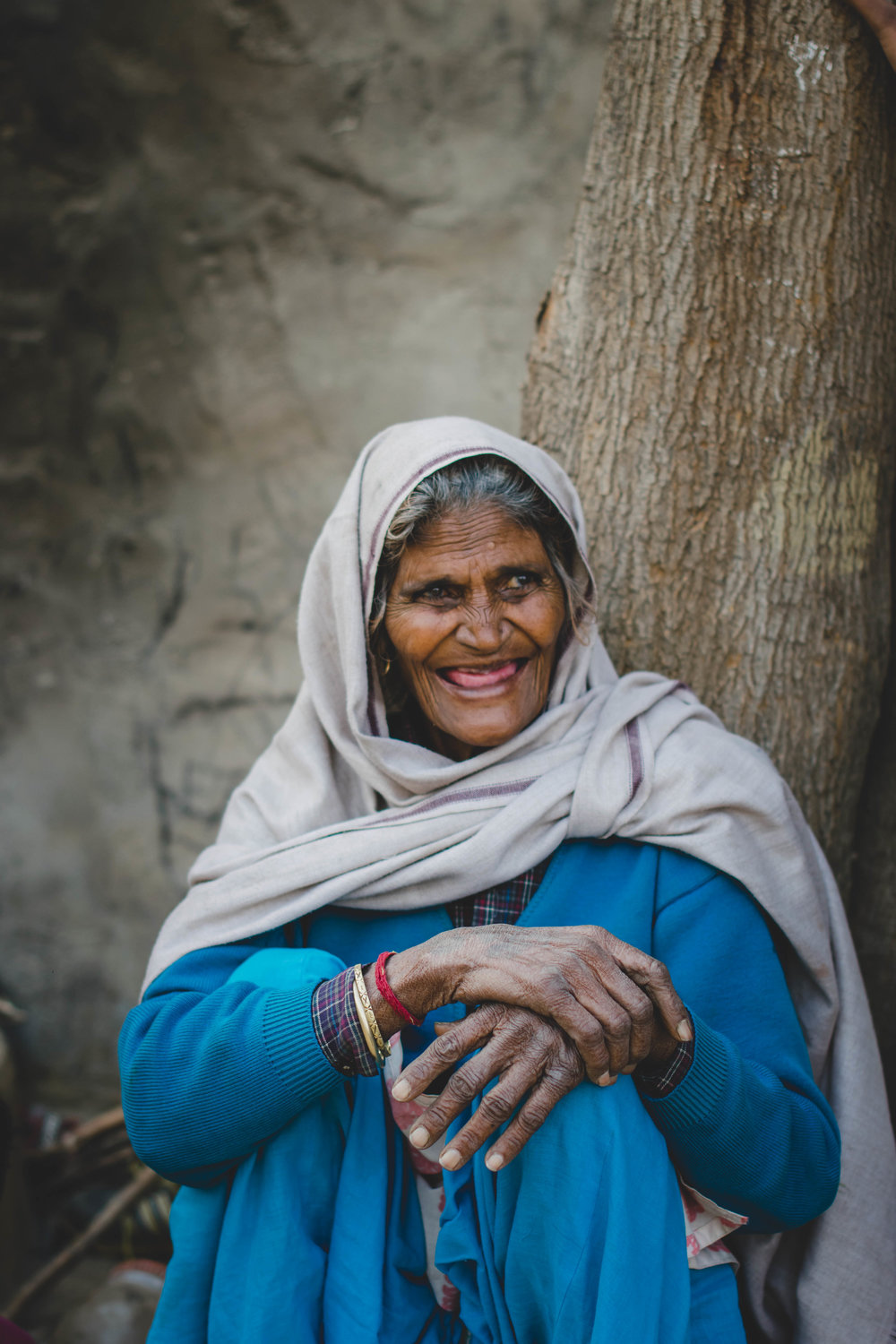 A toothless smile, deeply wrinkled hands, and joy in her eyes - this is Ram Rakhi. She has a million stories to tell and anyone who's met her knows she is eager to tell them.