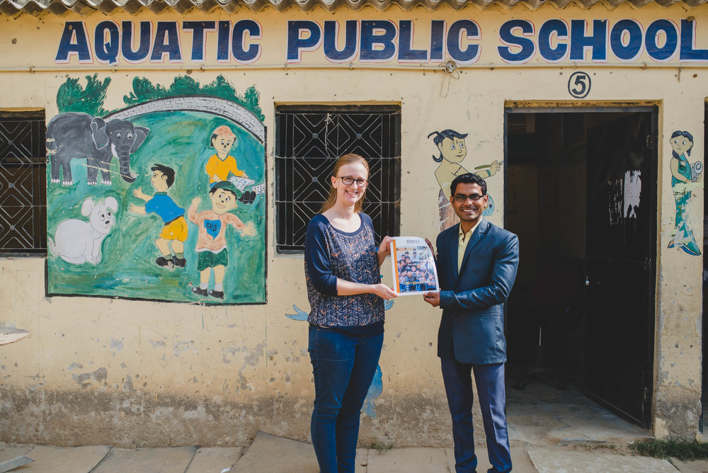 Rachel Nowlin and Principal Sunny display the teacher resource magazine that we wrote, translated, and printed for the staff of APS. Rachel spent a year abroad serving administratively and as a teacher at APS.