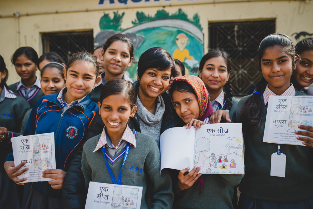 The girls at APS worked together to write and design their very own books! On this day, they received the physical copies of these books to take home. The girls were elated to be able to receive the fruit of all of their hard work!