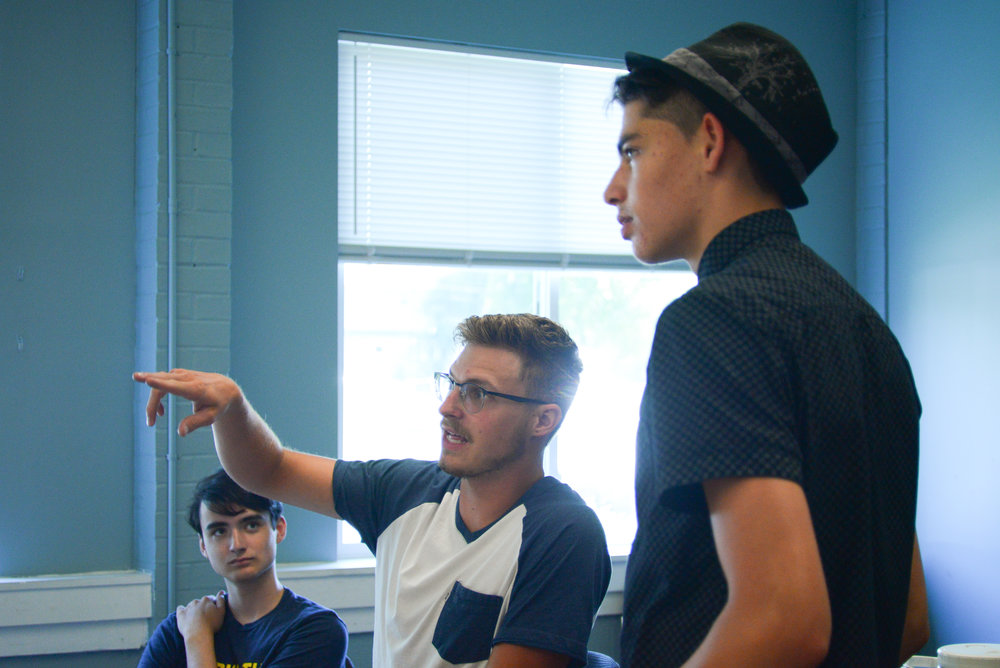 Austin Milliron helps his team foresee issues as they are planning for the basketball clinic that will begin next week! Austin is a student at the Institute for G.O.D. and this is his second year with WorkWell.
