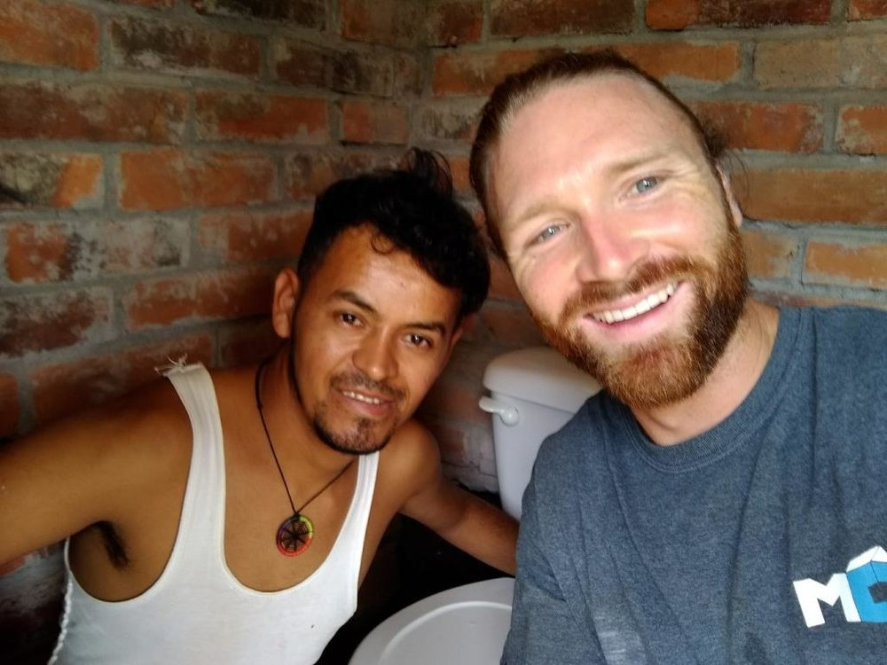 Kyle and Miguel successfully completed the renovation of a public bathroom, despite their language barrier.