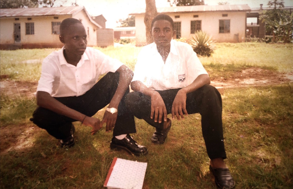 Nyago (right) pictured at Bombo Senior Secondary school in 1998 where he attended high school with Grace (not pictured).