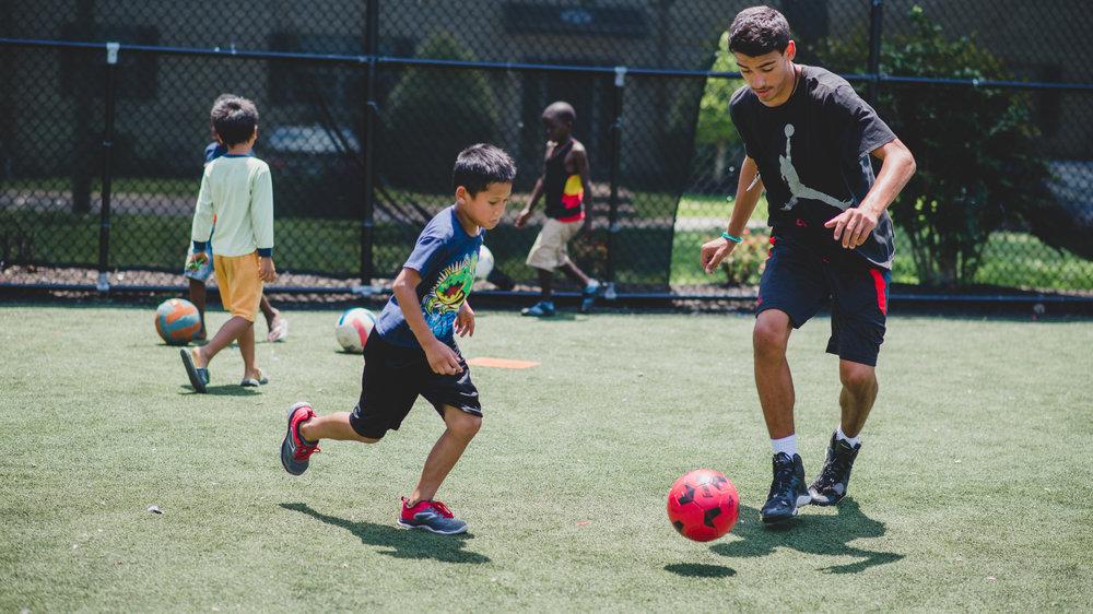 guy+playing+soccer+w+kid.jpg