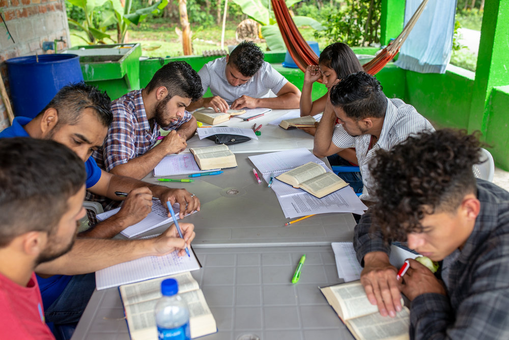 Rafael Reyes and Benjamin Reese work with our El Salvador interns to develop their critical thinking and literacy skills through the study of God's Word.