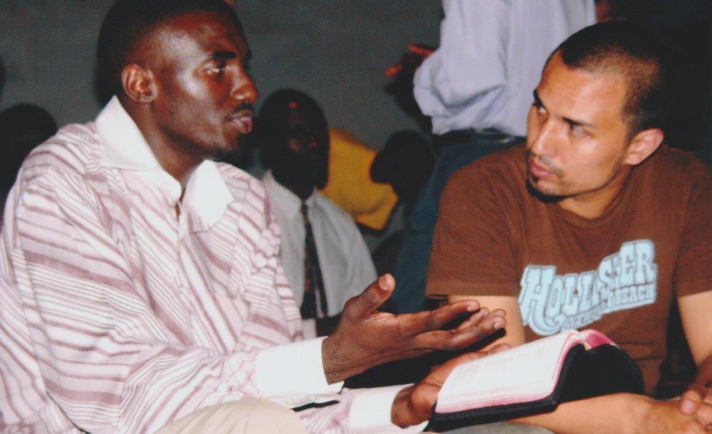 Gregg Garner discusses the Word with John in Uganda in 2006.
