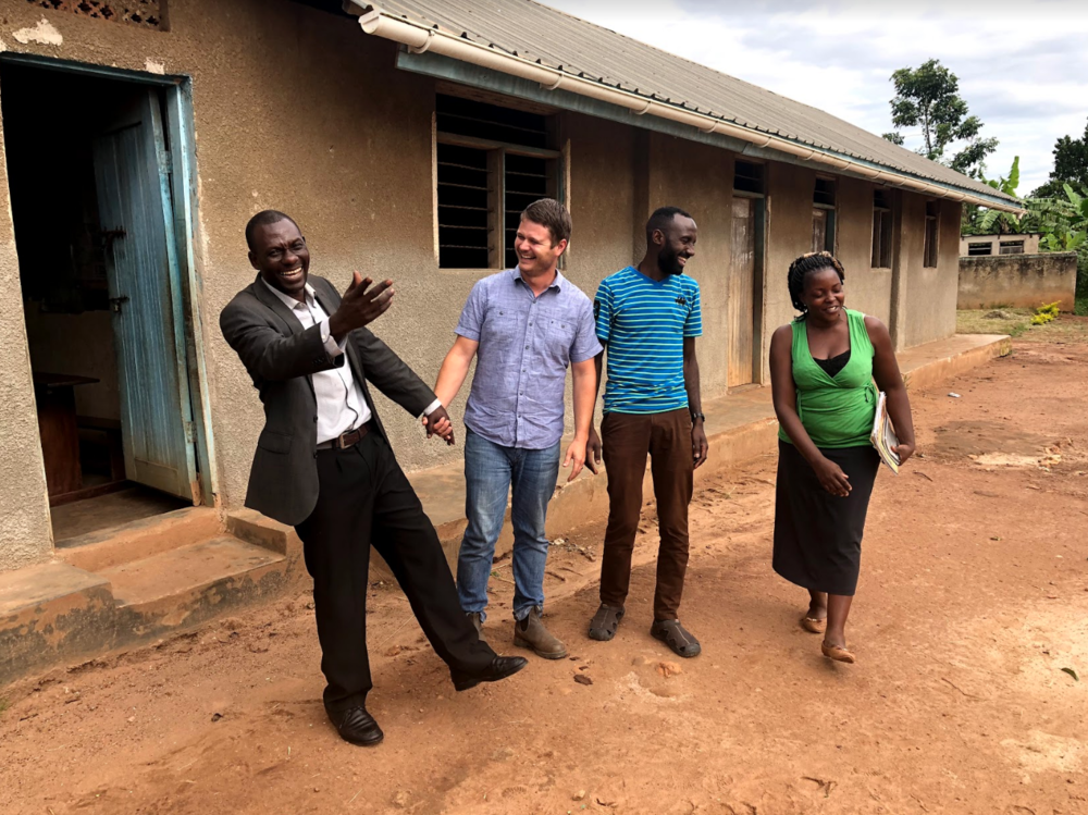 John continues to be involved in helping schools. Here, he meets with the headmaster at St. John's, G.O.D.'s partner school in Uganda, alongside Cameron Kagay, G.O.D. East Africa lead manager, and Josephine Nakimuli, a teacher at the school.
