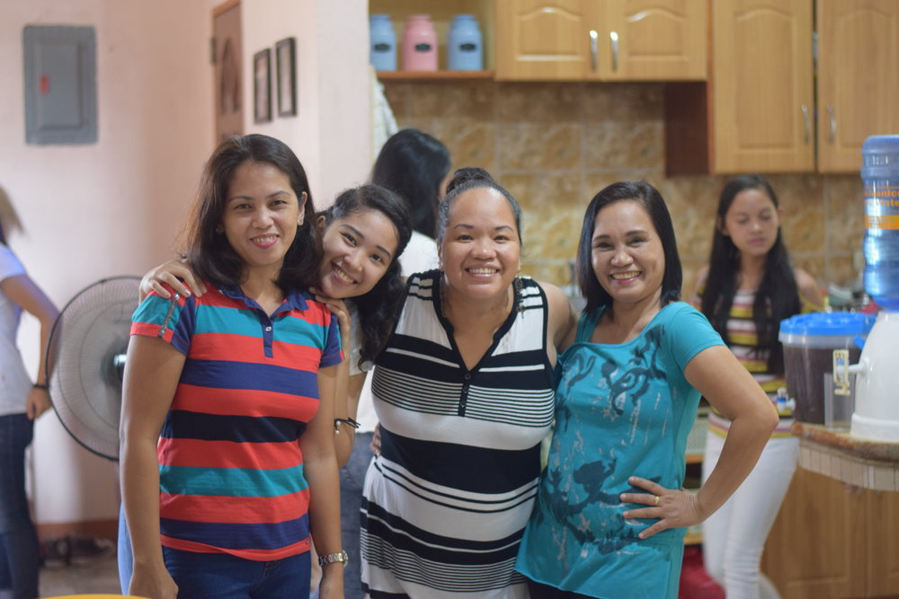 Rina Miller spends time with a couple of mothers and a sister to one of our Tahanan interns. Incorporating family into one's life and ministry is an important value of Filipino culture.