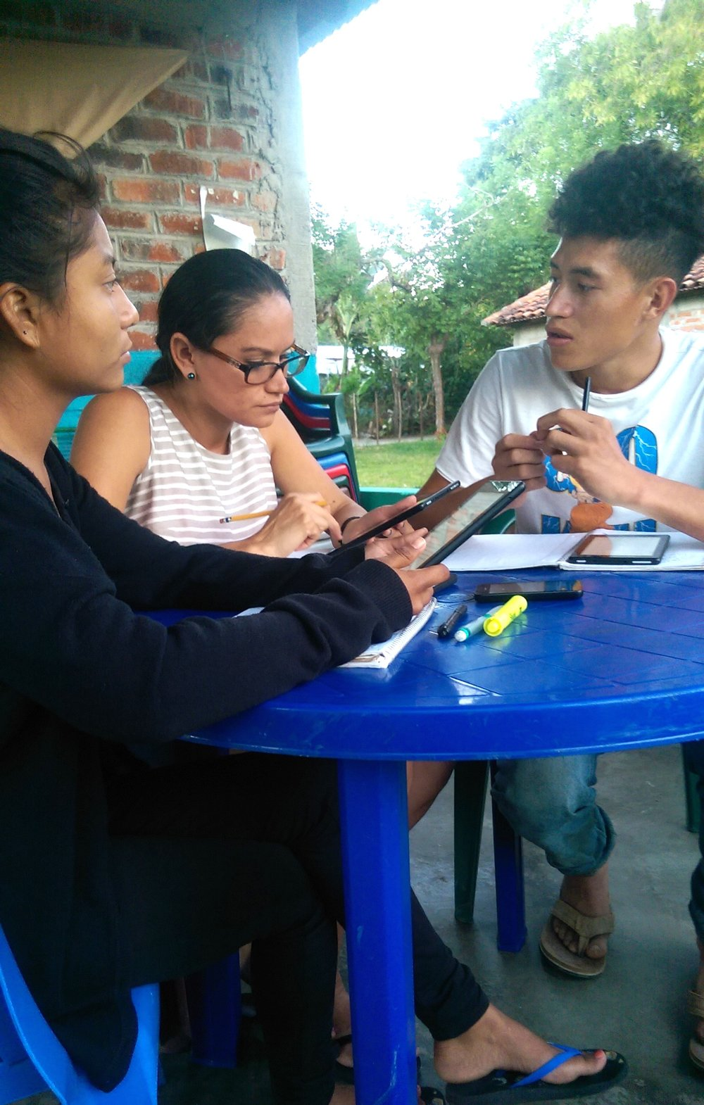 Lorena Mejia (middle), Doris Mercado (left) and Orlando Pineda (right) are taking an online class regarding Methods of Teaching taught by team members Betsy Johnson, Ben Reese and Rafael Reyes.Via the communication application WhatsApp, discussion with instructors involves their assigned readings, homework and volunteering in local classrooms.
