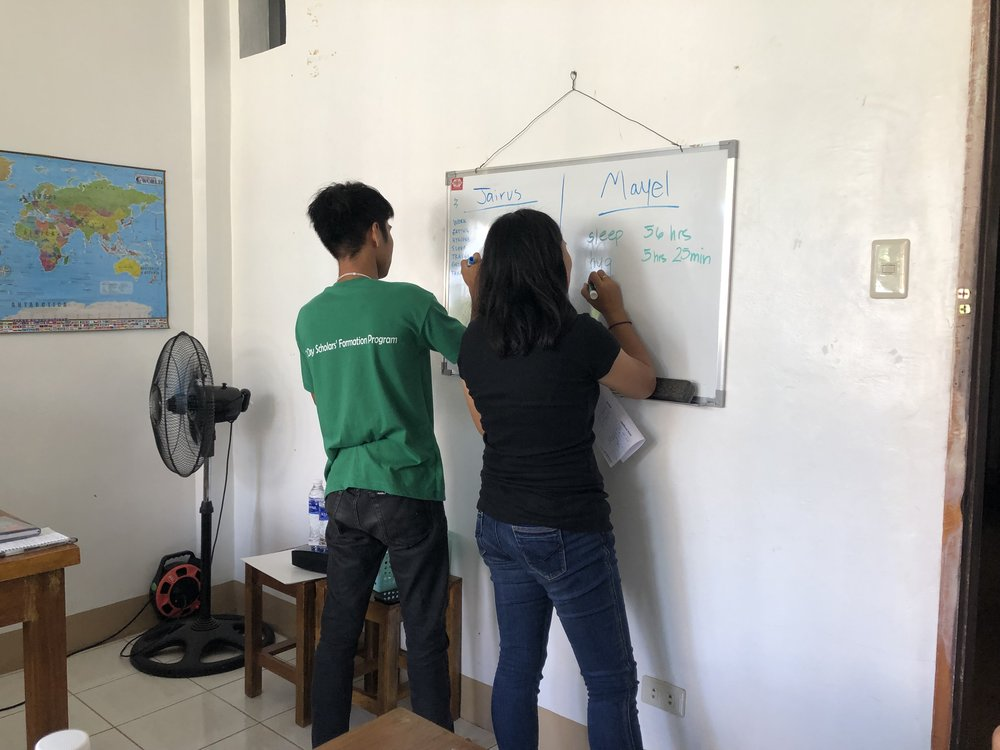 "SEA Interns, Jairus and Mayel, record how they ""spend their days"". This was a productive exercise for the young adults who are learning to manage their time well, to honor the Lord and serve others."