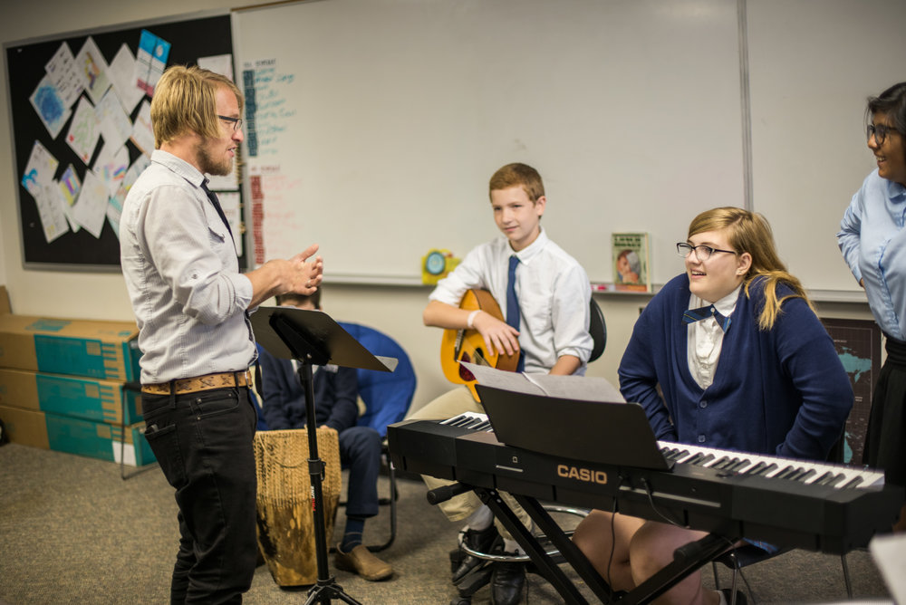 """Jr High teacher, Mr. Aaseby teaches a course titled """"Worship Band"""" at the Academy where the students learn the necessary skills to not only play an instrument but also facilitate a worship experience for others."""