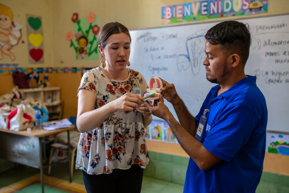 Anna Reyes (L) and student intern, Miguel (R) demonstrate how teachers can use their classrooms as a platform for teaching kids about dental health!