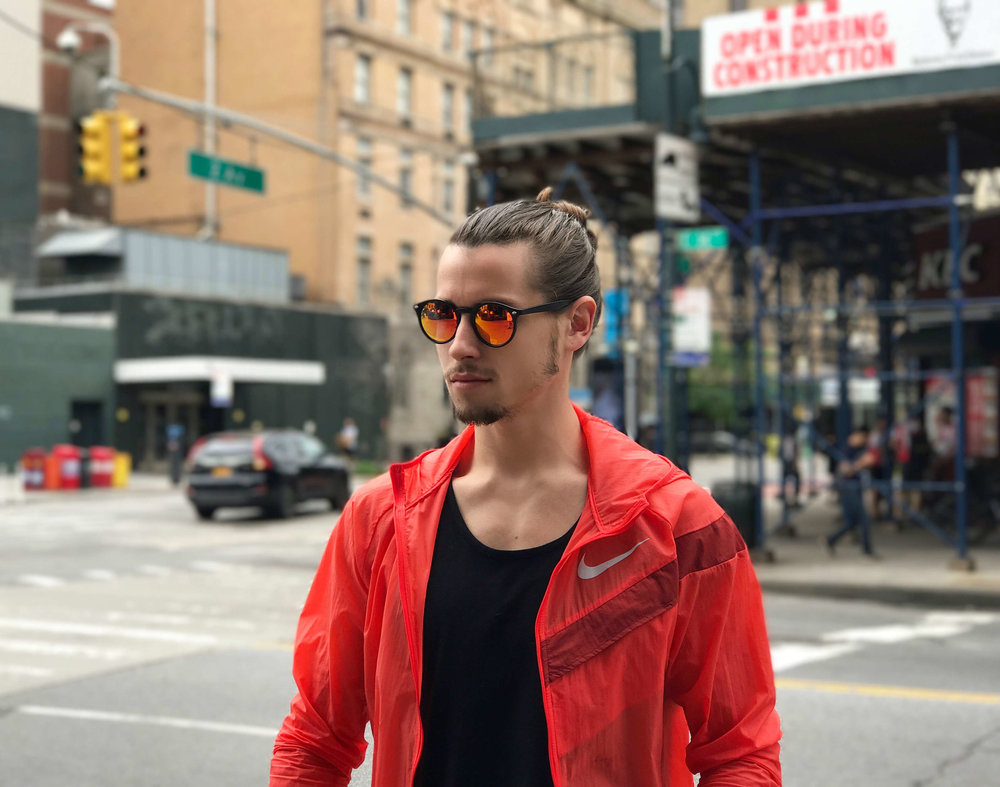 Christian Lowery Modeling Orange Glasses and Orange Jacket.jpg