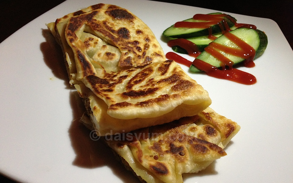 Murtabak - stuffed lamb pancake with cucumber and tomato relish