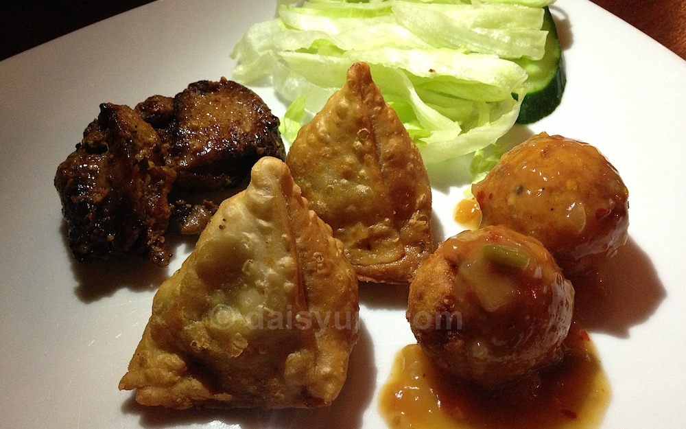 Ayam Panggang - Boneless chicken on skewers Popiah - Freshly made spring roll with lamb minceand potato  Sayur/ Bola - Balls of potato, cheese and veggies garnished with home made chili sauce