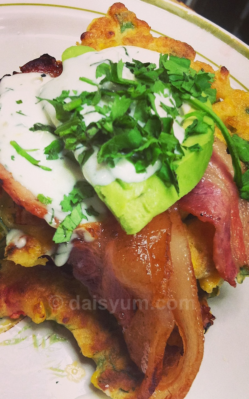 Home made corn fritters with avocado and bacon