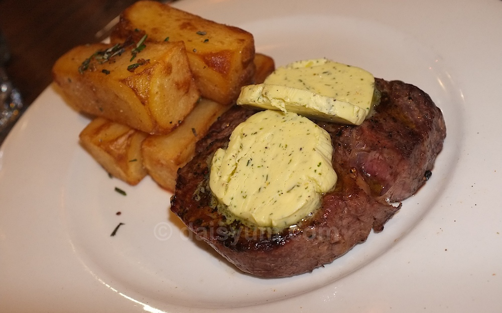 250 grams scotch fillet with hand cut chips & herb butter