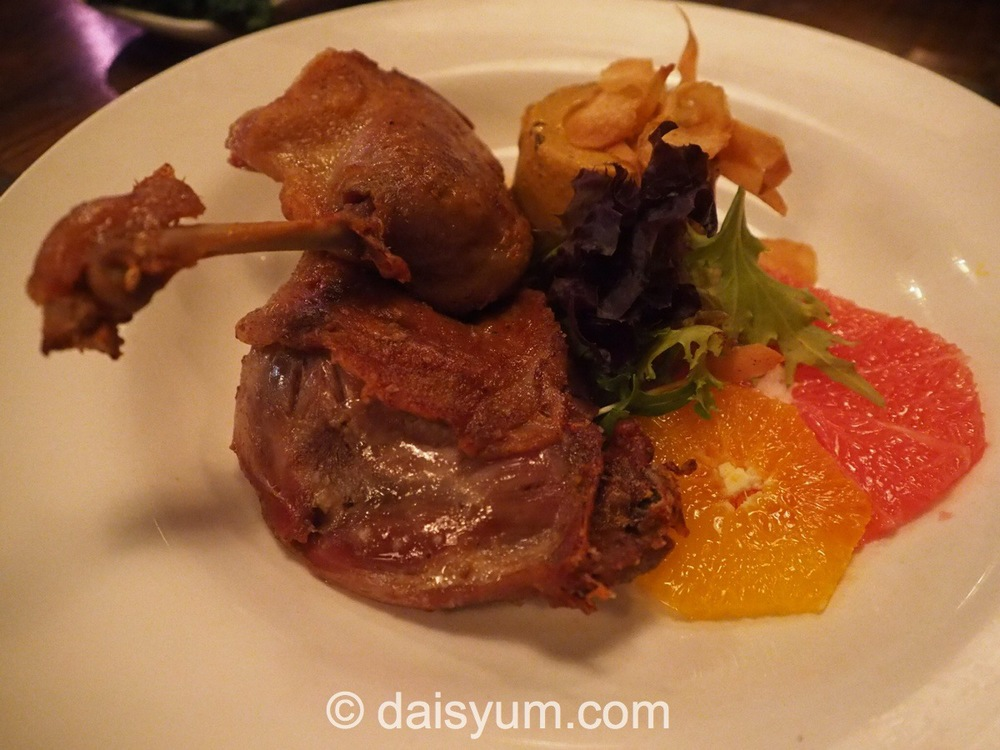 Duck Leg Confit - cooked duck maryland with a roasted carrot panna cotta & parsnip chips