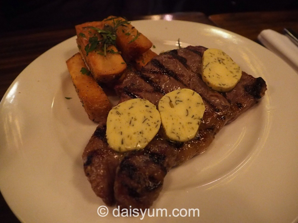 Porterhouse Steak 300gm, dry aged for 14 days served wit hand cut chips & herb butter
