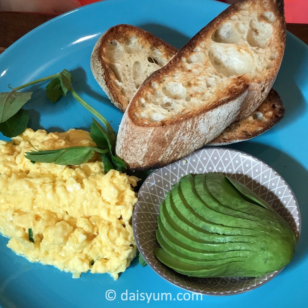 Toasted ciabatta with scrambled eggs and avocado