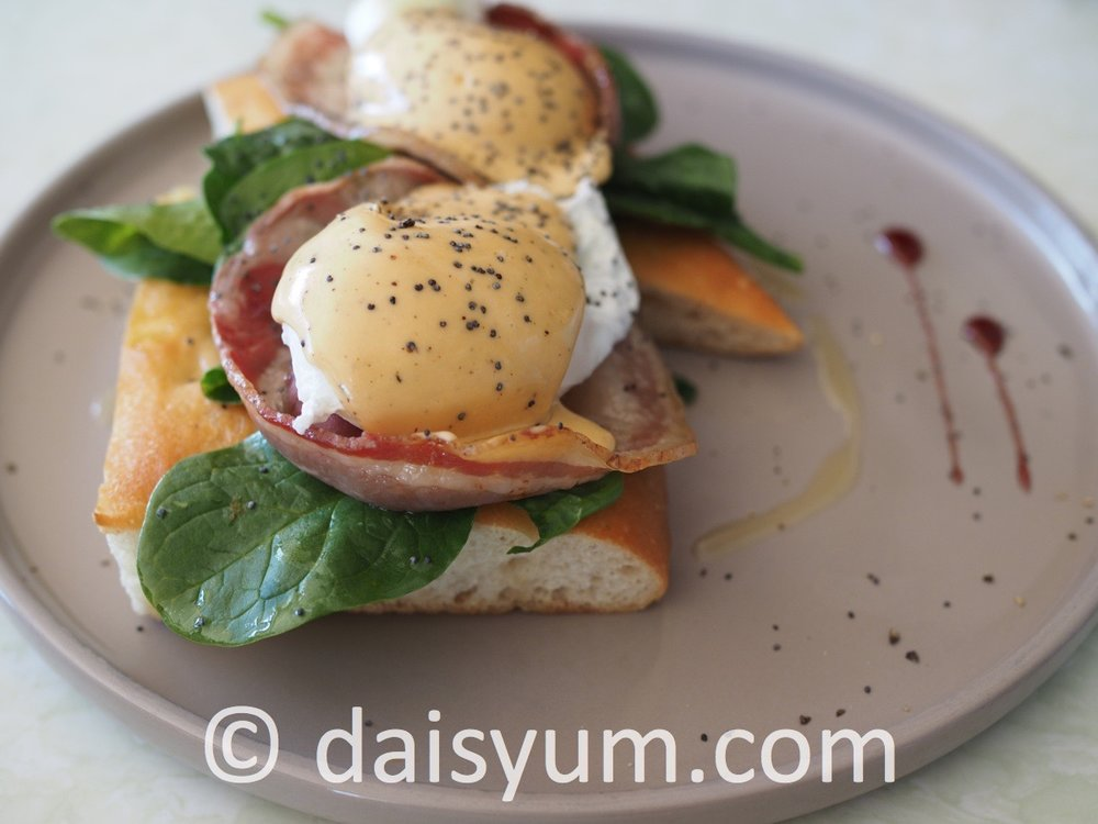BENEDETTO  GF Pancetta, soft poached eggs, rosemary bernaise, sweet wine reduction & baby spinach on sourdough focaccia