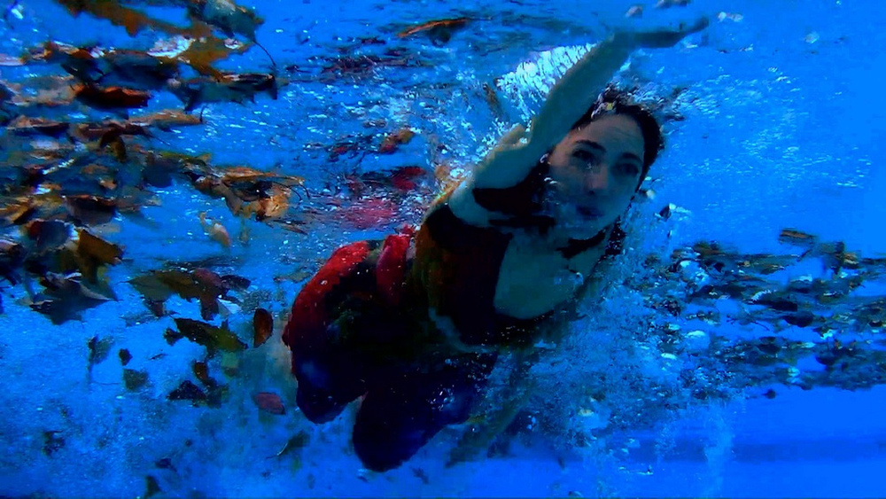 """Marisa Viola (""""Ellie"""") swims in the climactic scene of GET BETTER."""