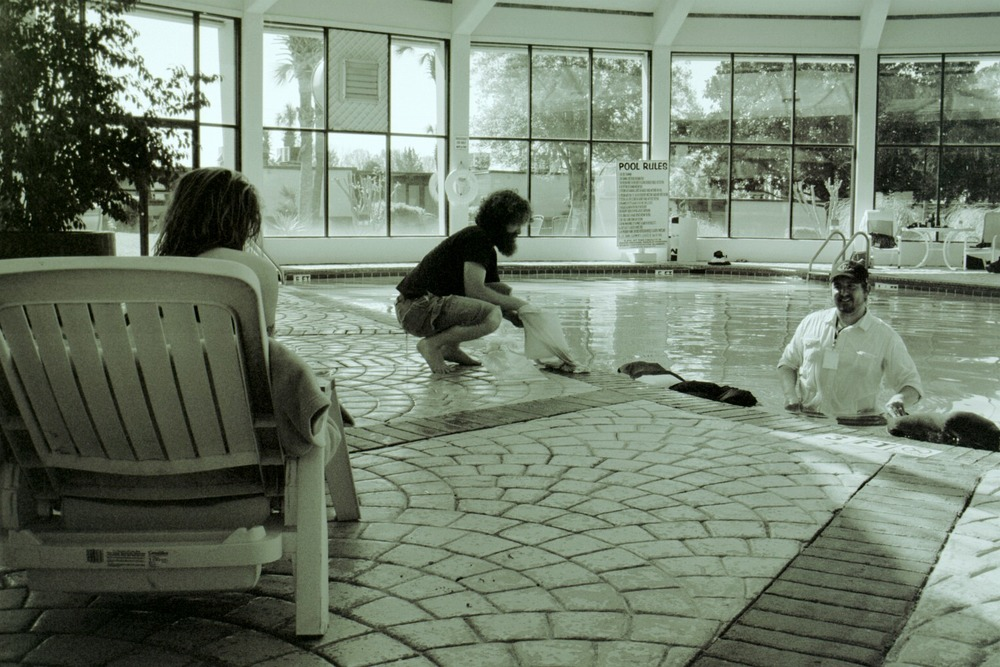 White (standing in the swimming pool) preps a shot for TAKEN IN with actor Madelaine Hoptry and cinematographer Daniel McCord.