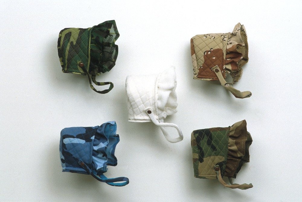 """War bonnets"" army regulated camo fabrics. dimensions variable"