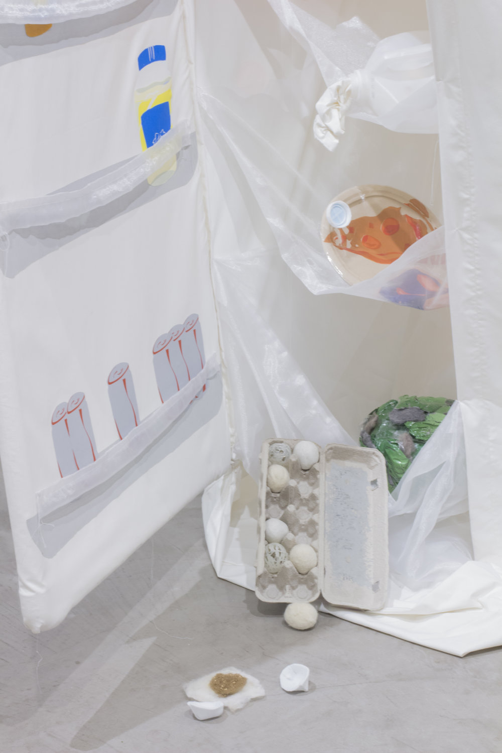 """Purging"" (detail), 2016, Screen-printed fabric, cardboard, milk jug, clay, felted wool, ink thread, pvc, monofilament, fridge light, Dimensions variable"