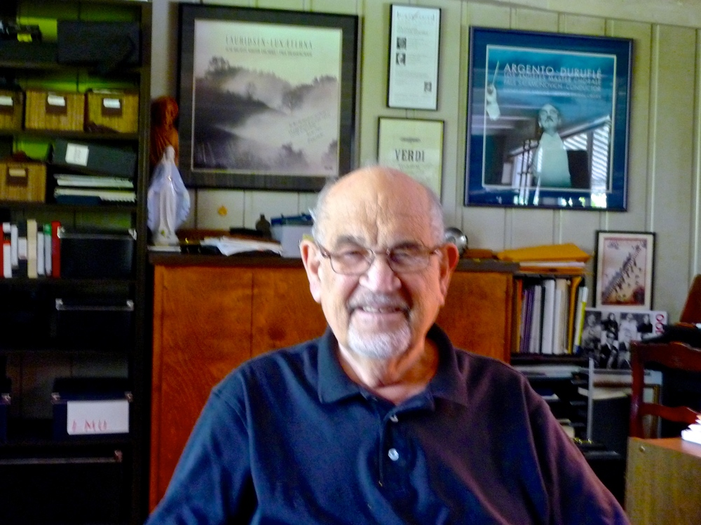 Paul Salamunovich in his office (framed reproductions of his LA Master Chorale CD covers hang on the wall behind him)