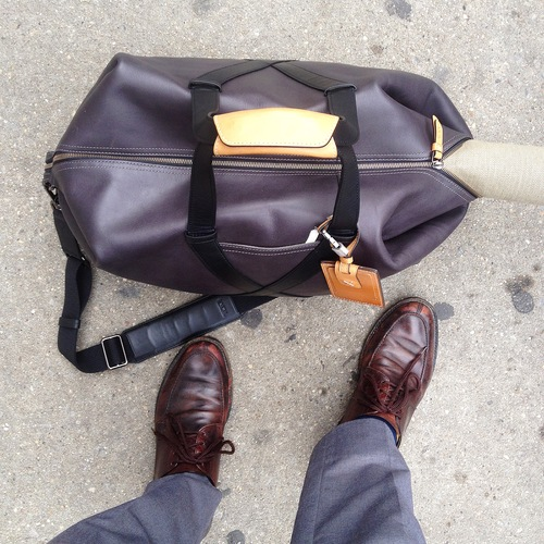 I already have a Tumi bag of my own that I have been breaking in. I carried it all around New York as a mobile showroom of my own. It carried my sketchbook, book page paintings, giveaways and fabric paintings. Occasionally it had cookies, cigars and whiskey.