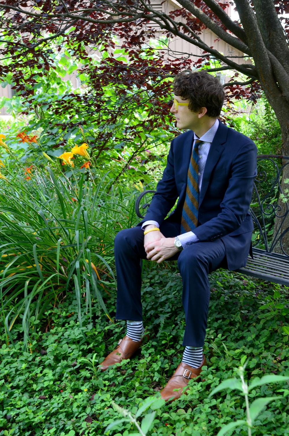 Sitting in Andre Phillipe Suit
