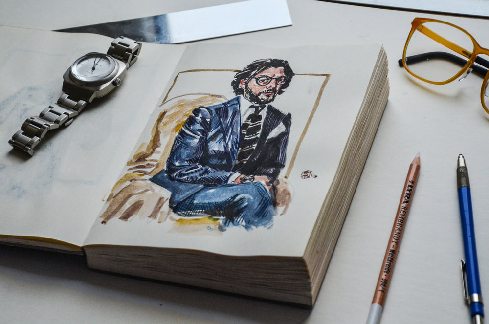 Sketchbook on table with illustrator tools featuring Nicola Ricci