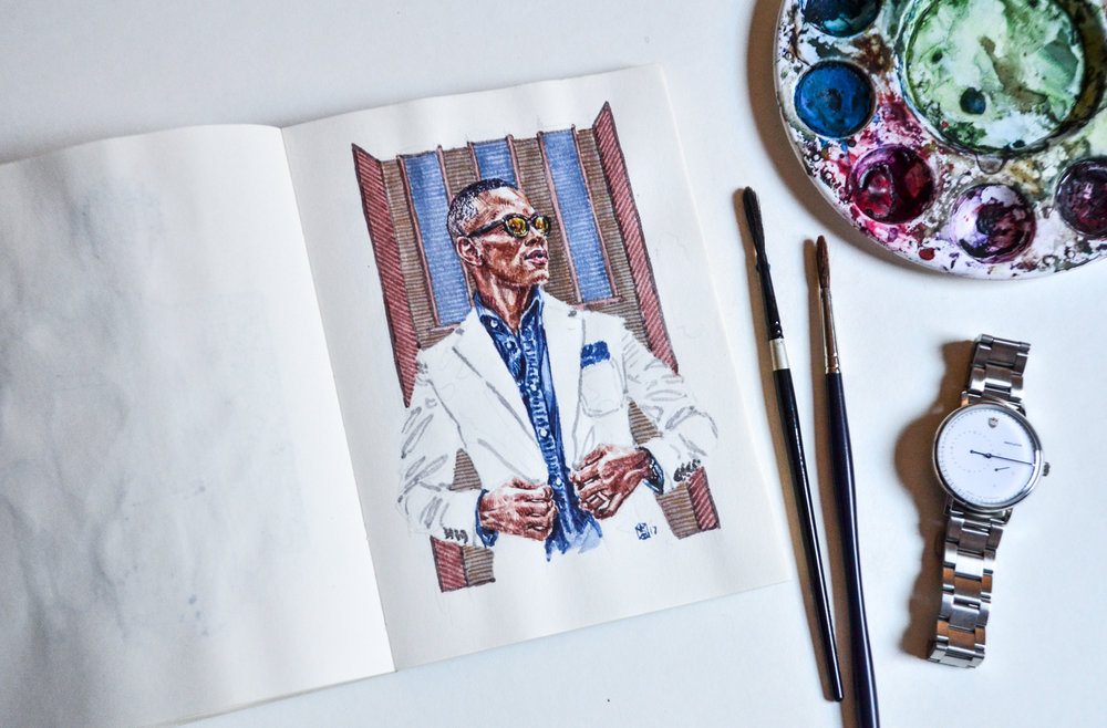 Sabir Peele portrait in sketchbook set in a flat lay