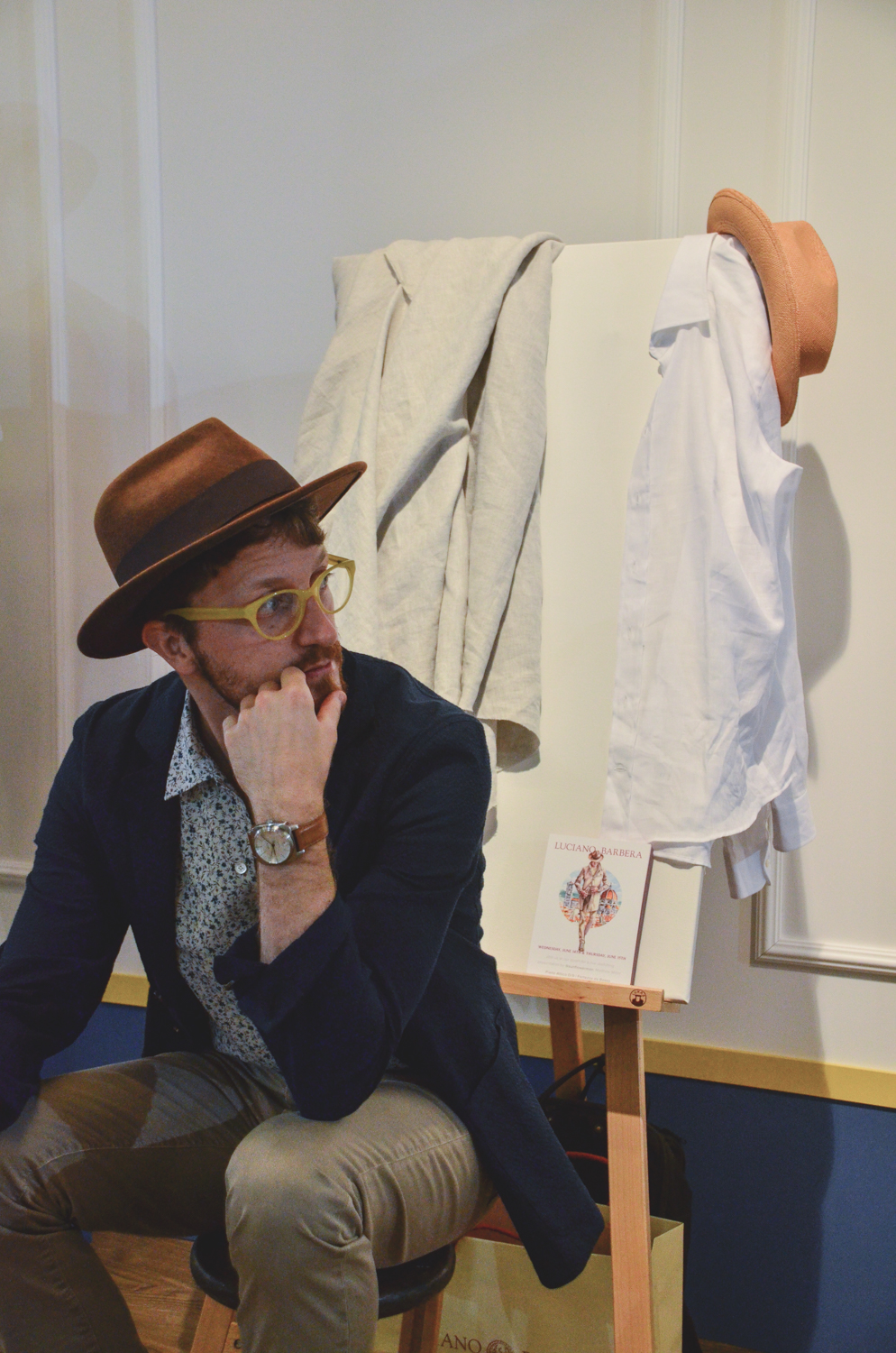 Sitting at the Luciano Barbera booth, preparing to make the live Pitti Uomo paintings