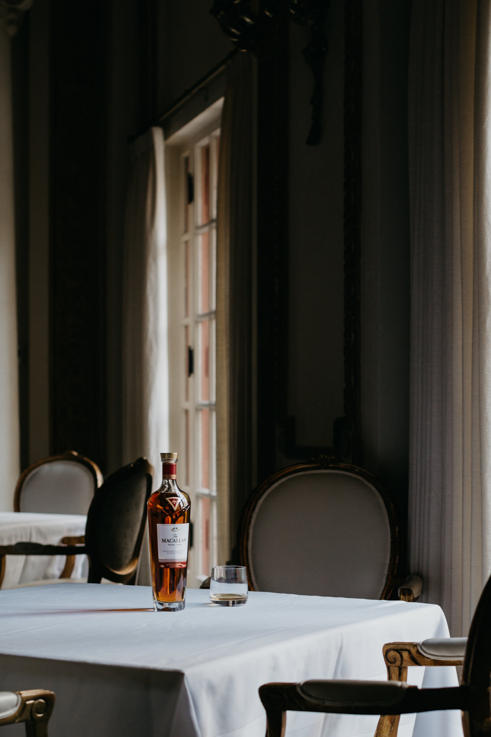 Bottle of The Macallan sitting on table in The French Room at the Adolphus Hotel. photo by Collin Sansom