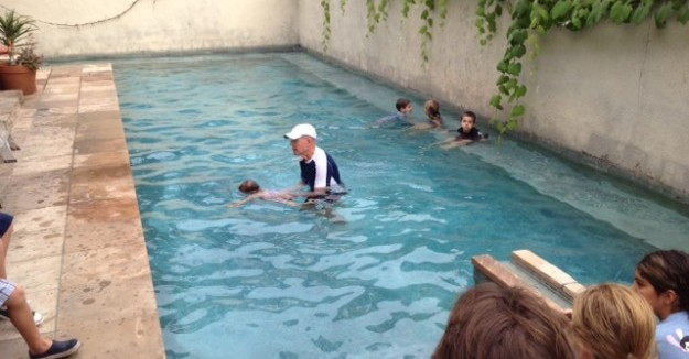 Tom Bradbury teaching the kids to swim.