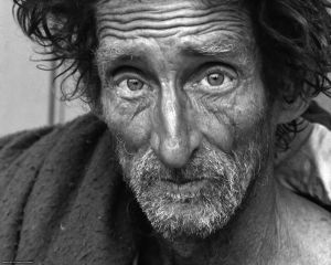 a homeless old white man staring into the camera