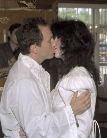 The author and his wife, Lina, kissing under the wedding chuppah in 1995