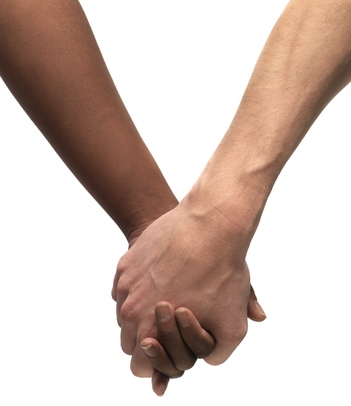 A black woman's hand clutching a white man's hand