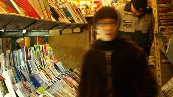 Image: Blurred figure in a newsstand, Pikes Place Market