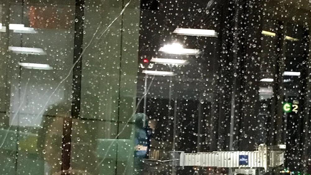 Image: Raindrops on glass, reflection of lights