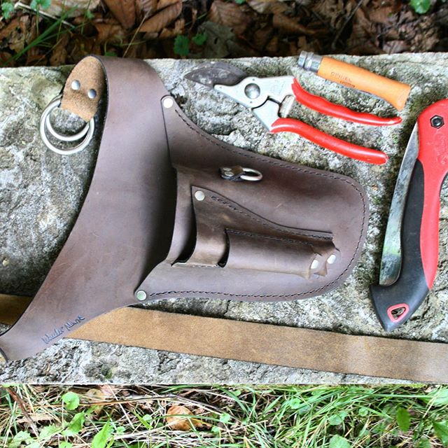 The Garden Belt + Knife Pocket is my first design that got my whole thought train rolling around tool belts for gardeners. I was up on a ladder pruning apple trees and found I just didn't have enough pockets or hands to keep my simple set of snickety-sharp tools together. While fussing with a pole pruner I'd cram my hand pruners, folding saw and knife in my back pockets  and they would poke and rub me the wrong way. Then I'd set one one of them down on the top of the ladder only to knock it off and have to climb down, pick it up, then climb back up again with the tools in my back pockets grinding my gears. Then I'd move to the next tree trying to herd my ladder and tools along with me. It seemed there just had to be a better way to go about this. You know what I mean? So this Garden Belt was born. Just trying to wrangle all the parts and pieces for a smooth work flow. Farming is hard enough work. No need to be fumbling around out there. #wheelermunroe #toolbelt #getittogether #nomoreholesinmybackpockets