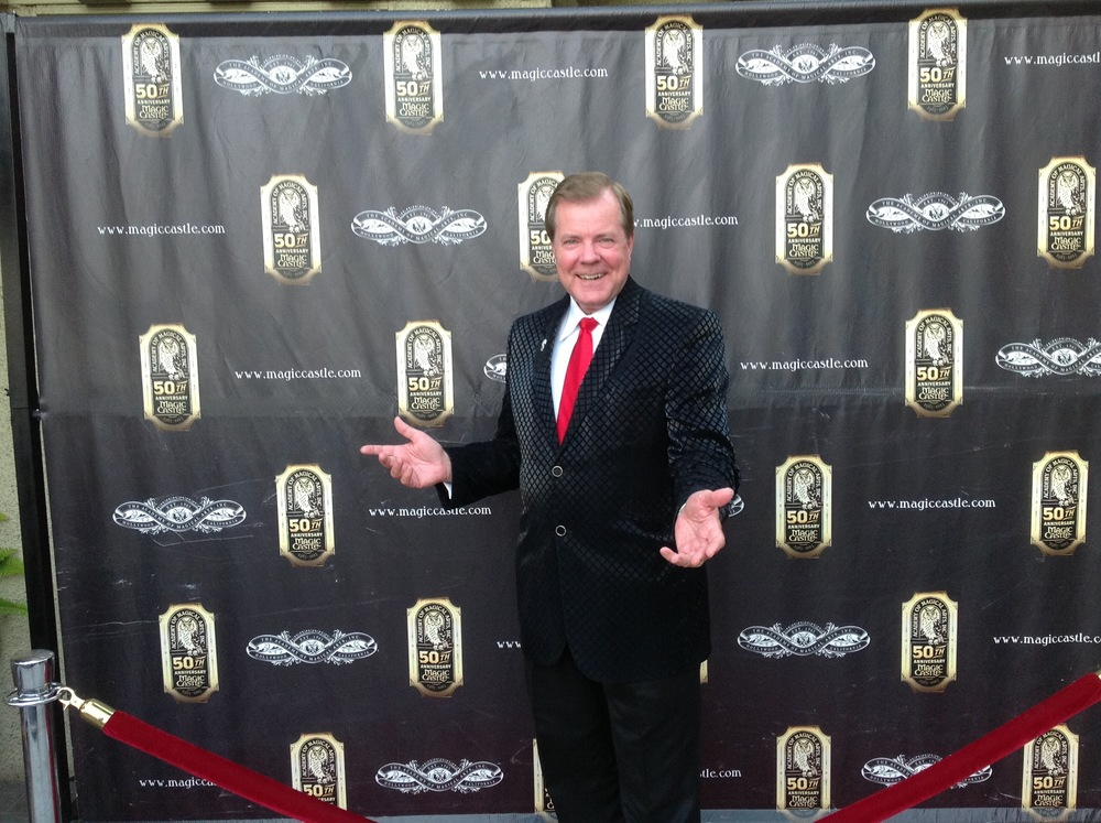 On the red carpet in front of the Magic Castle.
