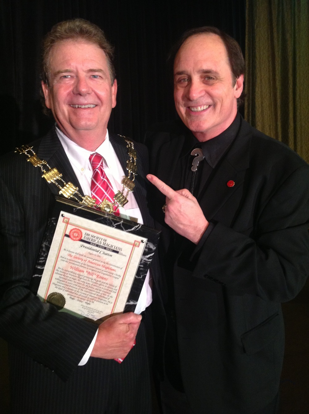 I.B.M. International President Bill Evans receiving certificate from S.A.M. International President Dal Sanders