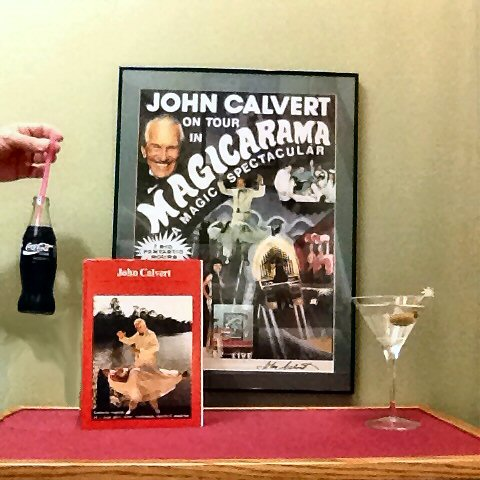"John Calvert ""floated"" a Coca Cola bottle with nothing but a straw and so impressed the management of Coke that they agreed to sponsor his tour. He shared that secret with me when he visited in 2009. Being the teetotaler he was, I will have my vodka martini but lift a bottle of Coca Cola to John. Cheers!"
