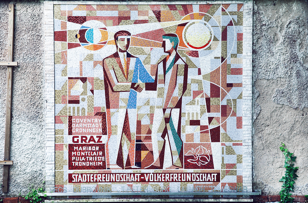 Reminds me of the Soviet mosaics. I also like how the guy on the right shoots lasers from his eyes into another guy.