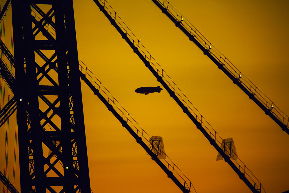 Zeppelin through the wires of Williamsburg Bridge. Canon 5D Mark III.