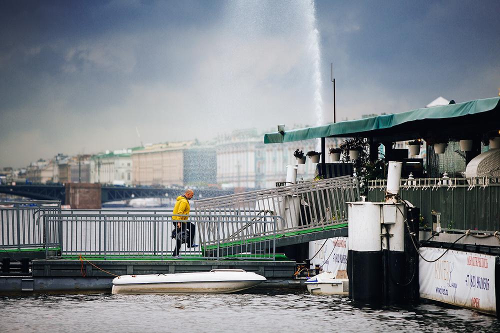 Man walking on a barge at Neva River