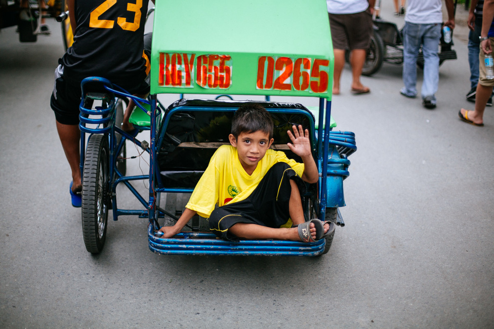High five! One of the most popular public transport in Philippines. A bike or motorbike with carriage on the right.